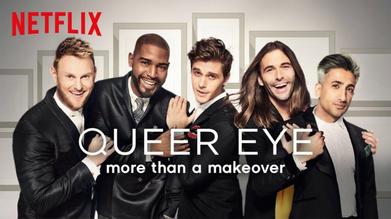 The Queer Eye team are standing alongside each other and are wearing suits. They are posing and looking into the camera. The words QUEER EYE more than a makeover are below the Queer Eye team