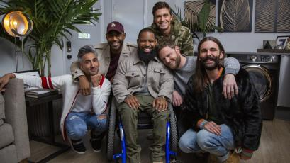 The Queer Eye are posing with Wesley in the middle of them