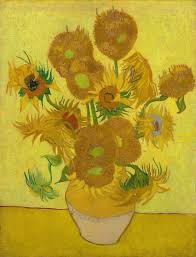 Van Gogh's painting of sunflowers in a vase with a yellow background